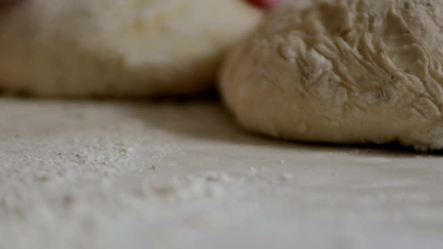 bread dough ready to be shaped flower on table video
