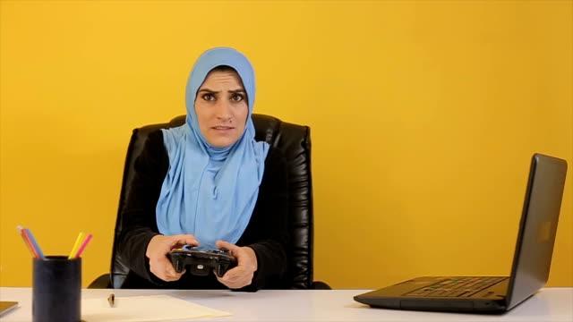Break at work,Arab businesswoman playing games video
