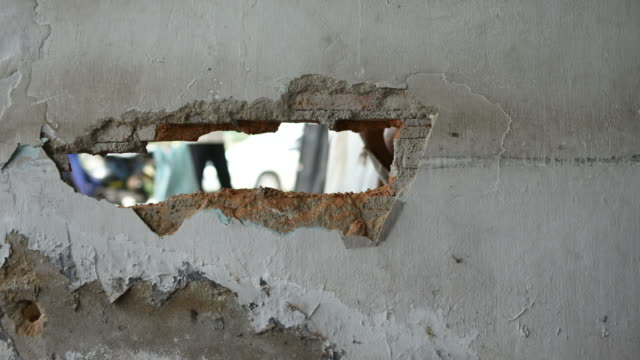 Break brick wall by drill, Timelapse video