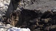Breaker (hydraulic) cuts frozen soil stock footage video video