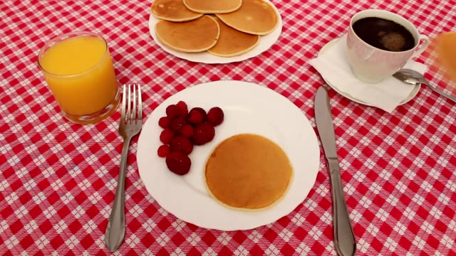 Breakfast of pancakes with strawberries and cream video