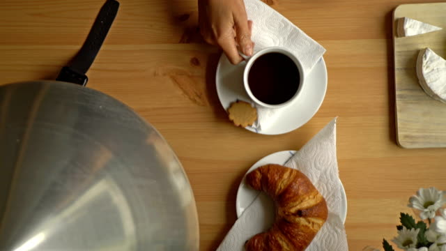 Breakfast With Coffee, Croissant And Smart Watch. Top View. Dolly Shot. video