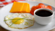 Breakfast with fried egg and black coffee video