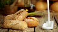 Breakfast with Rolls and Milk in Rustic Kitchen video