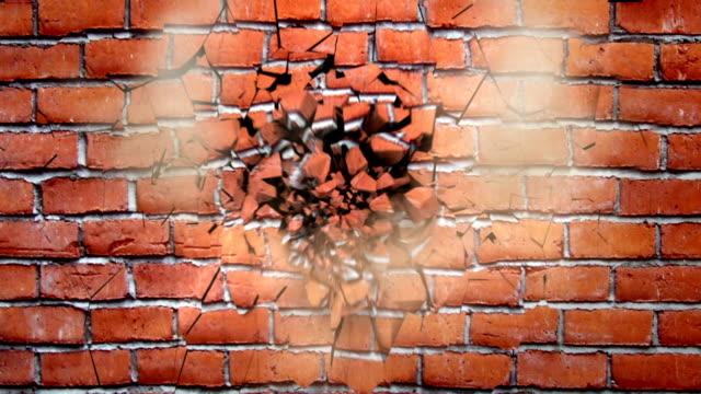 breaking brick wall video