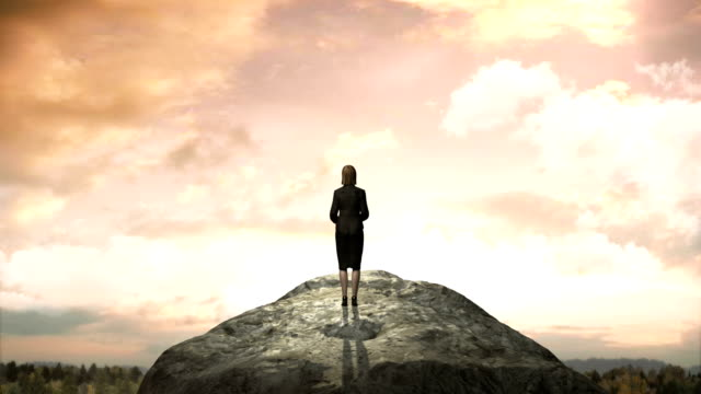 Breaks wall. Businesswoman standing at the edge of cliff. eventide. video