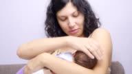Breastfeeding a cute newborn baby. video