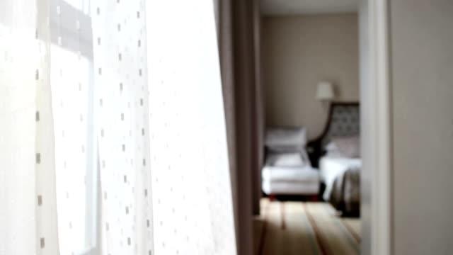 breeze blowing a curtain through an open window video