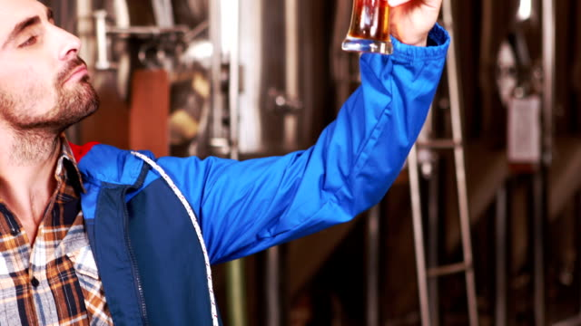 Brewery worker checking the product video