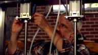 Brewery worker checking the vats video