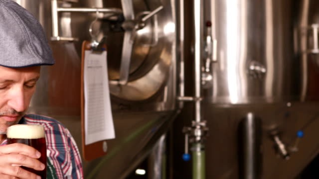 Brewery worker holding a beer video