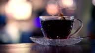 Brewing hot black tea in cafe video