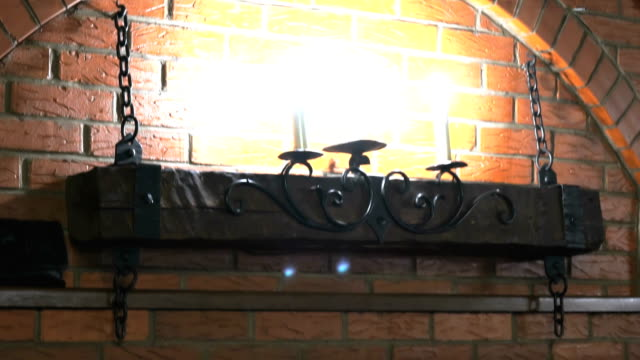 Brick wall with lamps, deer antlers, two guns video