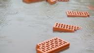 Bricks in a puddle in the rain video