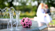 bridal bouquet and two glasses of champagne video
