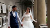 bride and bridegroom in a beautiful building video
