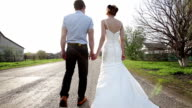 bride and groom are on the road away video