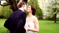 Bride and groom being happily married on their wedding day video