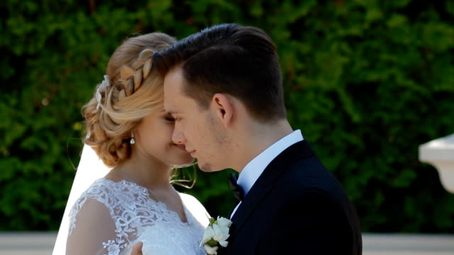 Bride and groom dance outdoor in sunny day video