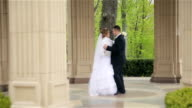 bride and groom dancing in the beautiful park video