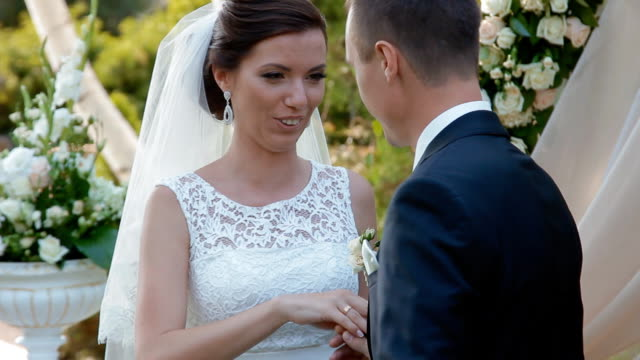 Bride and groom exchange wedding rings video