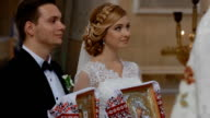 Bride and groom get married in church video