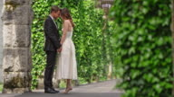 SLO MO Bride and groom holding hands in passageway video
