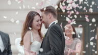SLO MO Bride and groom in a rose petal shower video