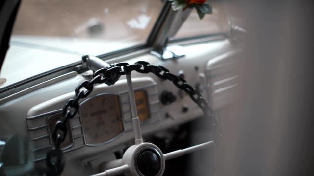 Bride and groom inside retro car video