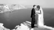 bride and groom kiss on the coast and the doves in their hands video