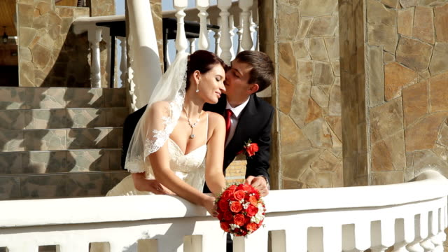 Bride and groom on a balcony video