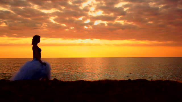 bride at sunset video