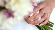 Bride holding wedding flowers video