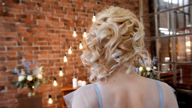 Bride in stylish serenity dress walk away and turn her head video