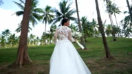 Bride is walking on the island. video