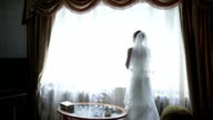 Bride looking out of the window video
