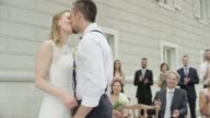 Bride placing ring on her groom and they kiss video