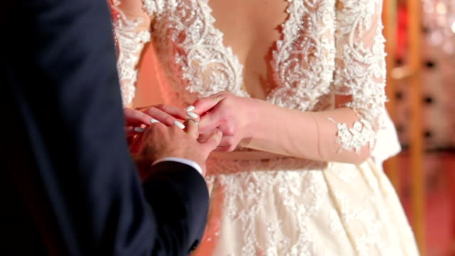 Bride Putting a Wedding Ring On Groom's Finger video