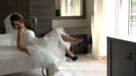 Bride sitting on bed. video