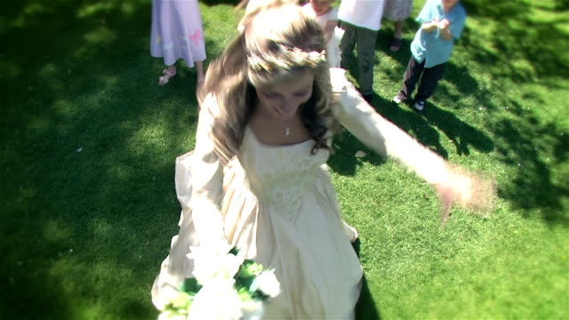 Bride throws a bouquet at her wedding video