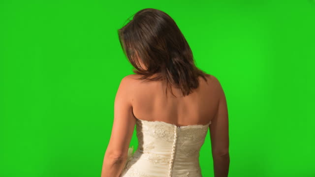 Bride walking away, looking back and flirting. Shot on Green Screen. video