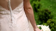 Bride walking with bouquet in hand video
