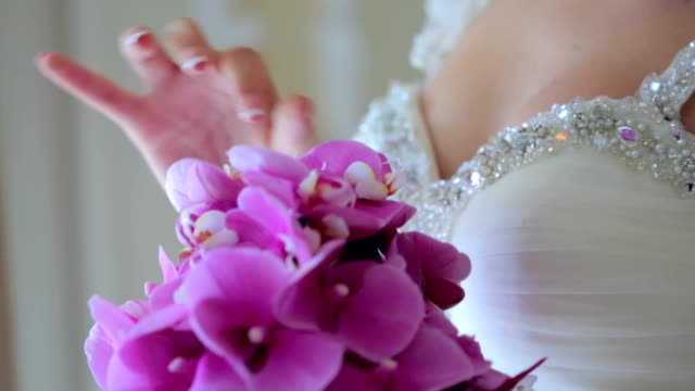 Bride With Her Beautiful Bouquet of Orchids video