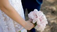 Bride with wedding bouquet of pink peones video