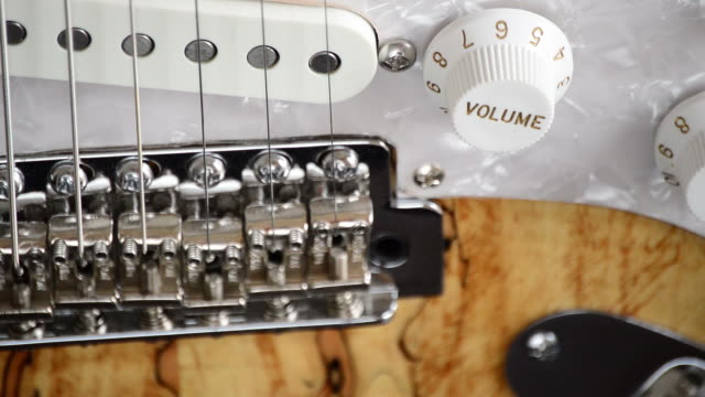 Bridge and controls of electric guitar turning video