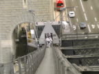 Bridge Climbers on Ladder from Above, Quick Pull to Traffic video