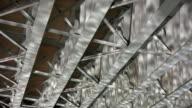 Bridge girders river reflections. Motion background. video