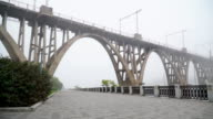 Bridge on the waterfront in the fog video