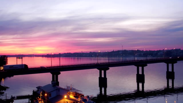bridge over the river in beautiful pink sunset, aerial shot video