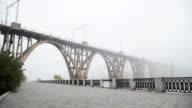 Bridge stretching into the fog video